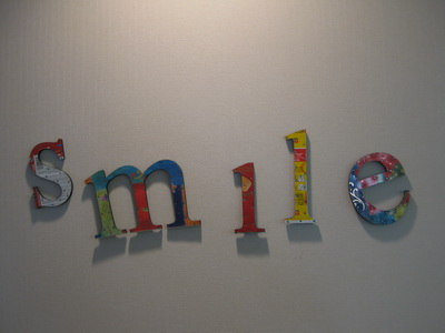 Office photo of smile words on wall